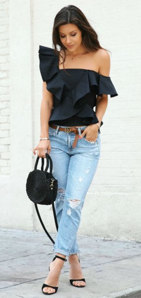 black strapless blouse with ruffled shoulder and light blue slim fit jeans