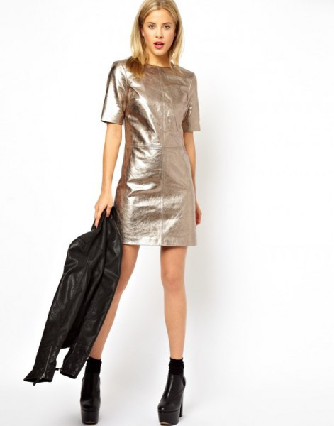 silver short-sleeved metallic mini dress with black moto jacket
