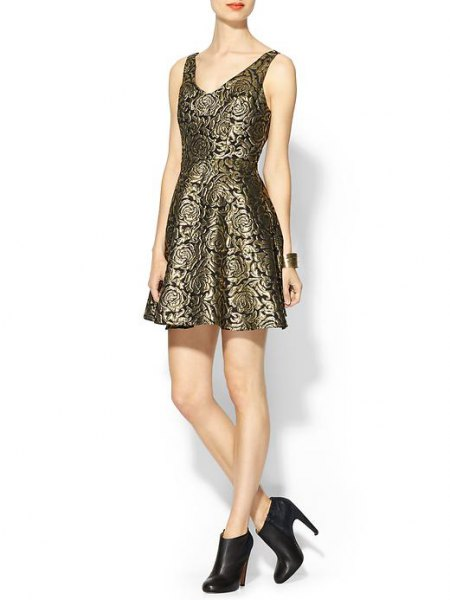 Bronze and black printed, form-fitting mini dress with leather boots