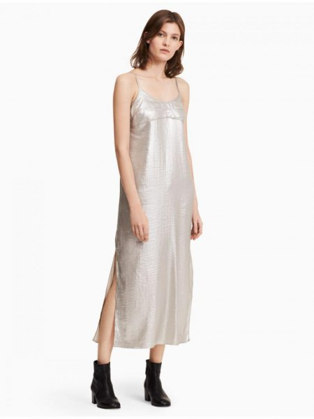 silver maxi dress with spaghetti strap and scoop neck and black leather ankle boots