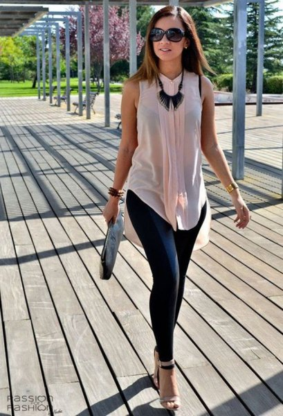 Light pink sleeveless chiffon blouse with dark blue skinny jeans