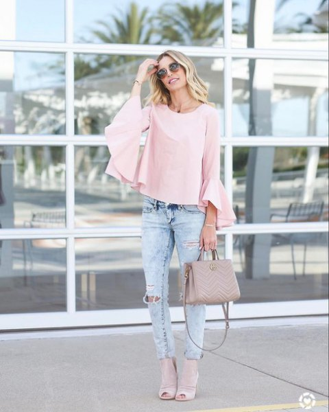 Light pink blouse with bell sleeves and slim jeans
