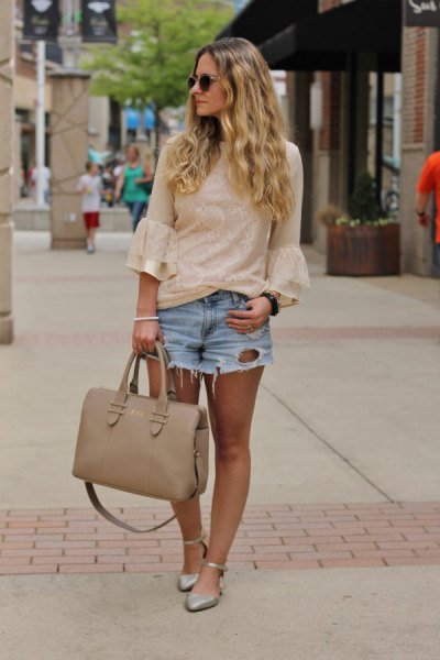 light pink bell-sleeved blouse with blue denim shorts