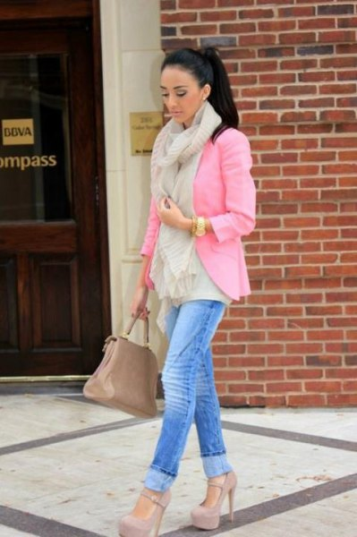 pink blazer with blue cut slim fit jeans and high heels