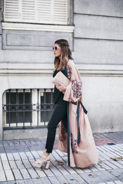 Blushing maxi coat with black top and matching skinny jeans