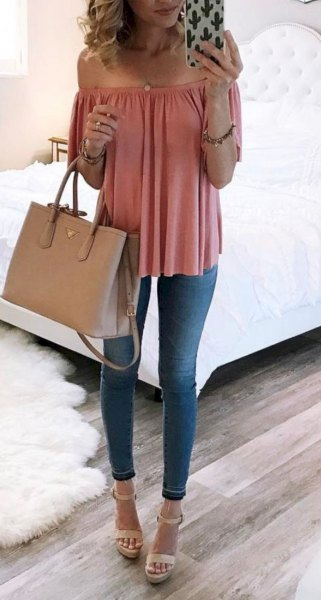 Blush pink off the shoulder blouse with blue skinny jeans