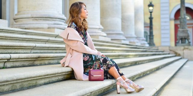 Light pink wool coat with black floral dress and rose gold platform heels