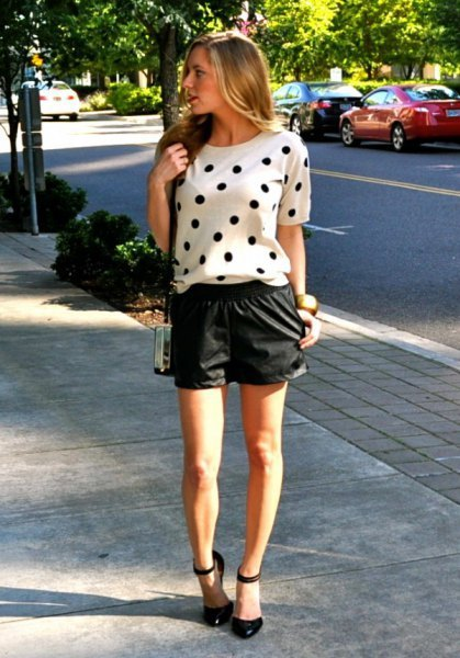 white short-sleeved sweater with polka dots and black leather shorts