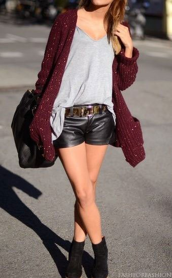 gray, ribbed cardigan with black leather shorts with belt