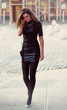 black, short-sleeved, form-fitting mini dress made of synthetic leather with leggings