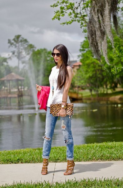 white sleeveless top with clutch with leopard print and pink strappy heels