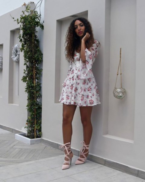 white and blushing mini swing dress with half bell sleeves and pink heels