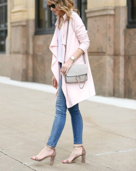 white longline blazer with blue skinny jeans and strappy heels