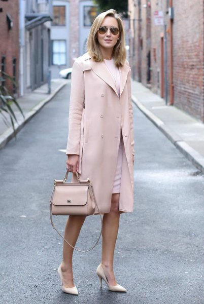 Light pink longline wool coat with a white, figure-hugging mini dress with a round neckline