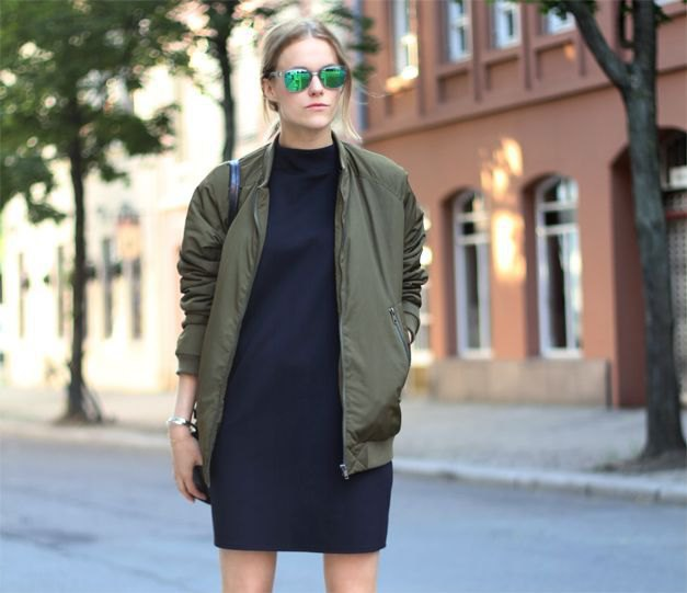 green pilot jacket with black t-shirt dress