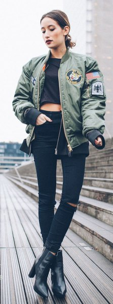 gray pilot jacket with black, short-cut t-shirt and leather boots