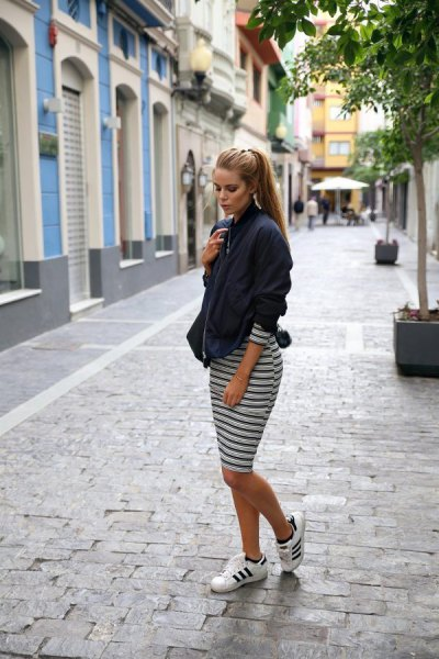 black blazer with striped midi dress and running shoes