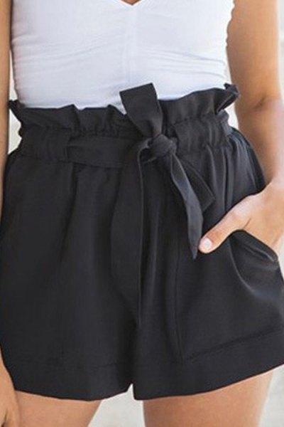sleeveless blouse with white V-neck and black mini shorts