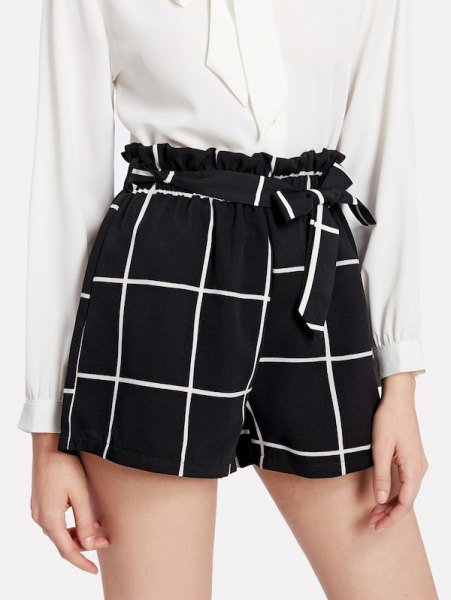 white blouse with button closure and checkered shorts with black tie