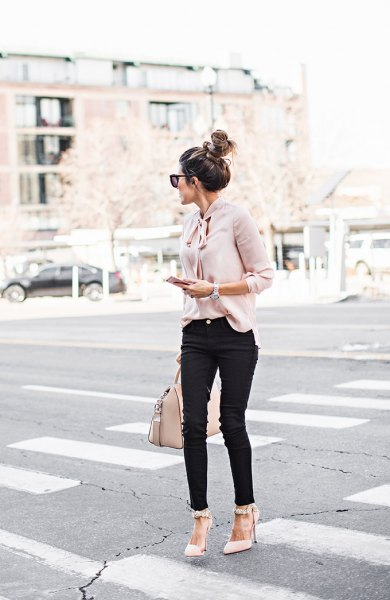 Light pink blouse with black jeans and pointed toe heels