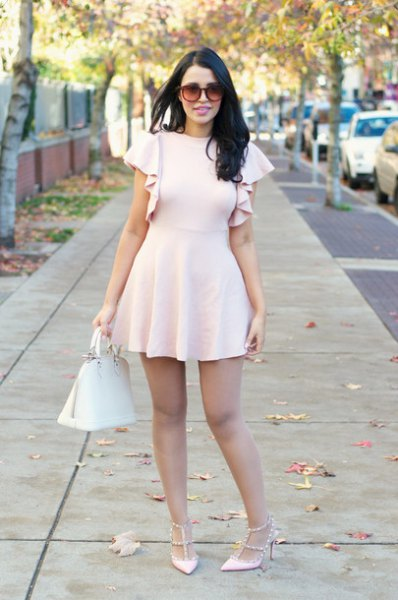 light pink heels with a matching ruffle sleeve fit and flared mini dress