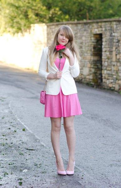 white blazer with blushing mini swing dress and light pink heels