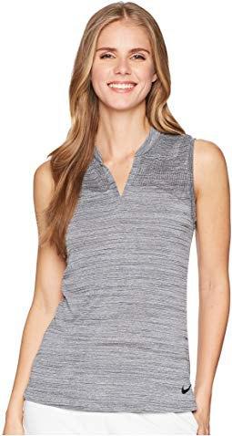 gray sleeveless sleeveless polo shirt with white pants