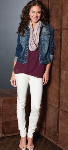 black tunic shirt with blue denim jacket and cream-colored slim fit jeans