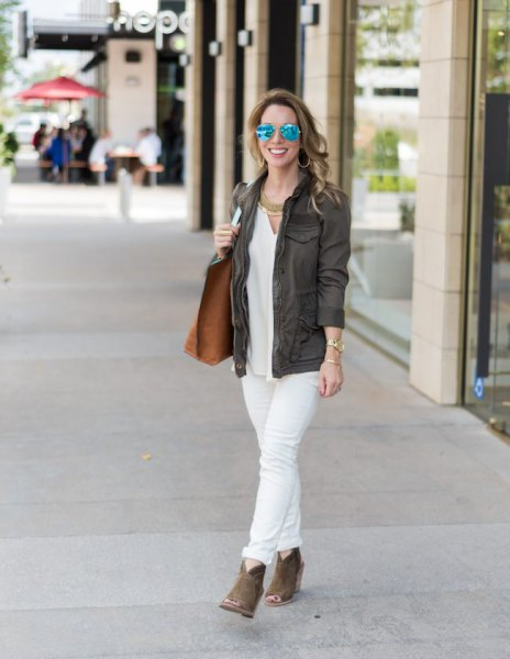 gray blazer with white blouse and cuff jeans