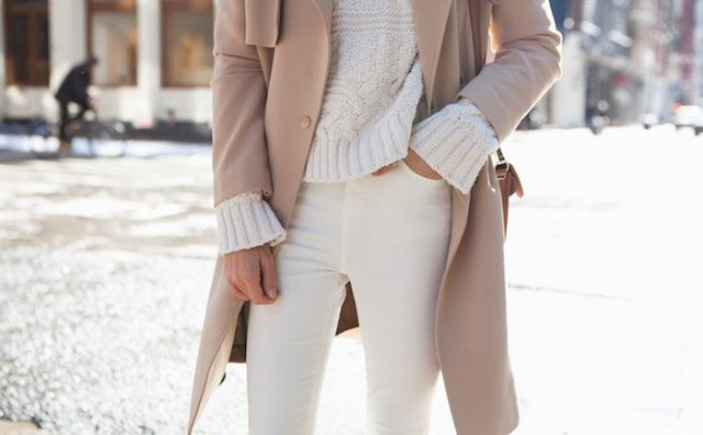 Chunky sweater in ivory with a red coat and cream-colored jeans