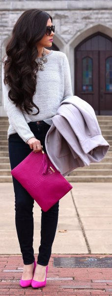 gray sweater with pink clutch handbag