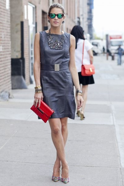 gray tank mini dress with belt and red leather handbag