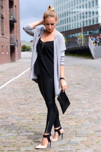 light blue longline cardigan with black clutch handbag