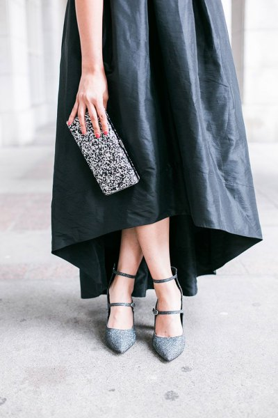 black leather maxi dress with silver sequin clutch