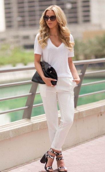 white t-shirt with v-neck, slim fit jeans with cuffs and sandals with leopard print