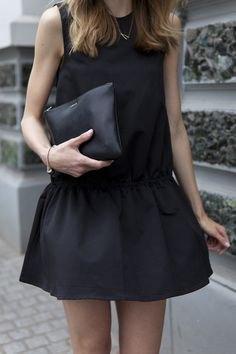 black tank top with mini rat skirt and leather handbag