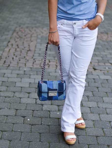 Light blue t-shirt with white jeans and a jeans shoulder bag