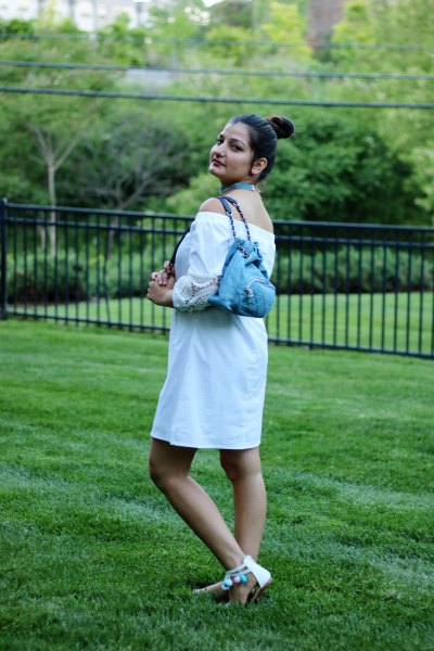 off-the-shoulder white mini blouse dress with light blue denim backpack