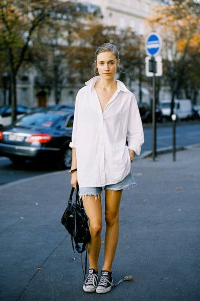 white oversized shirt with light blue denim shorts