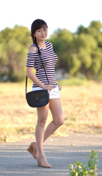 black and white striped cold shoulder top with scoop neck and handbag over the shoulder