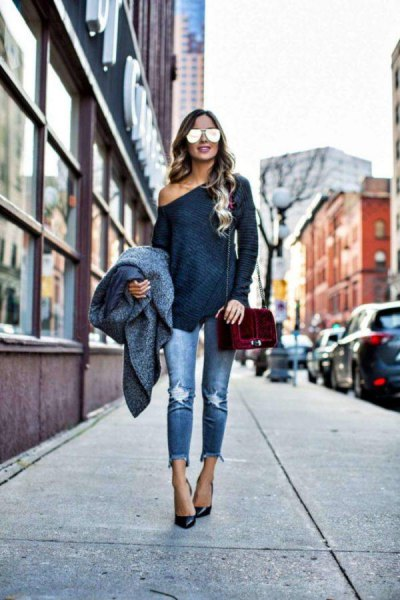 black long-sleeved t-shirt with a relaxed fit and torn jeans