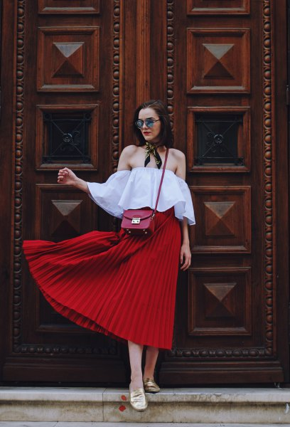 light blue off shoulder blouse with red midi pleated skirt