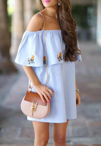 light blue, embroidered shift dress with flower pattern and pink purse