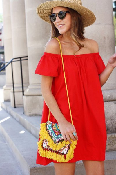 red strapless blouse dress with yellow wallet with tribal print