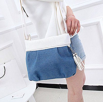 white sweater with mini blue denim shorts and shoulder bag