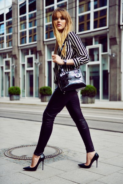 black and white striped shirt with buttons and leather leggings