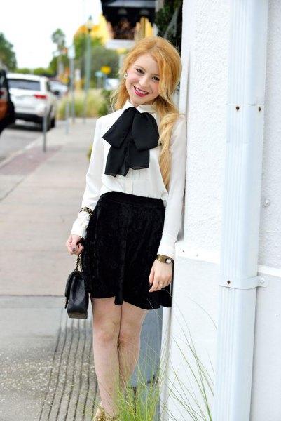white chiffon bow tie with black miniskirt