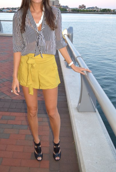black and white striped blouse with mustard yellow mini skirt