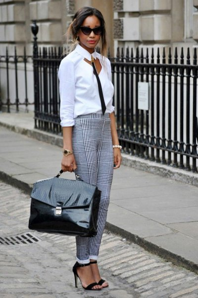 white and black blouse with checked chinos