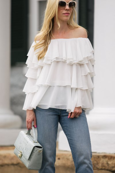 strapless multilayer ruffle chiffon blouse with blue jeans
